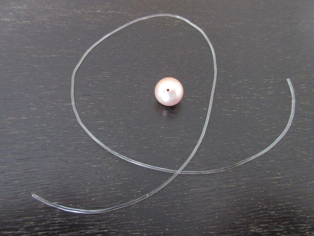 Perle gebohrt und Gummischnur