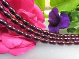 Hämatinstein in lila, schöner Strang aus Fässern mit 6x4mm