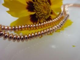 Hämatinstein in rosegolden, Strang allerfeinste Linsen 4,5mm