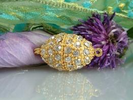 K7 -- Schönste Schließe, oval mit Steinen/ goldfarben