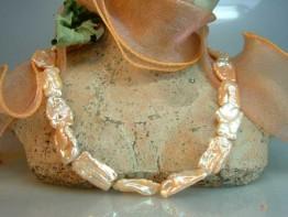Perlen barock - lachsfarbener Strang quer gebohrt 1a Lüster